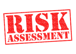 risk assessment in red capital letters on white background