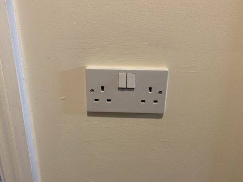 Double UK mains electric socket, switched off