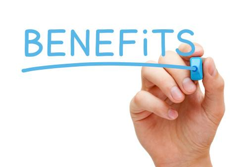BENEFITS written in blue ink by a hand - Benefits of PAT testing
